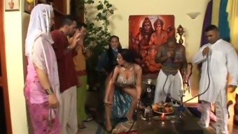 Plus sized Indian women moving seductively with the party
