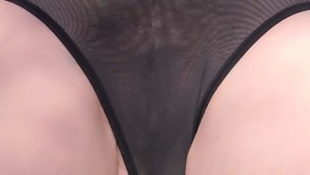 At a park on top of her back a very transparent one detail swimwear