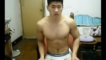 Strapping Chinese heart throb explodes his clothes and bad boys off his penis on web camera.