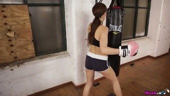 Charming looking boxer babe Tina Kay is stripping and fidgeting with her tits