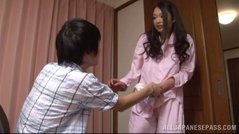 A charming Japanese people housewife gives her mankind a handjob