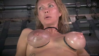 Big breasted mommy by using nipple clamps on and gets her muff toyed