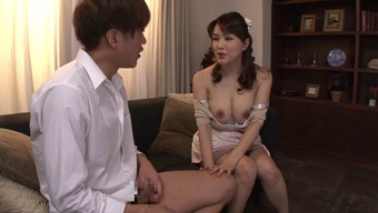 Busty Japanese housewife gives an sexual titjob and blowjob