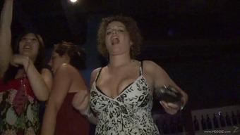 Dynamic event date flashes her naturally-occuring tits publicly