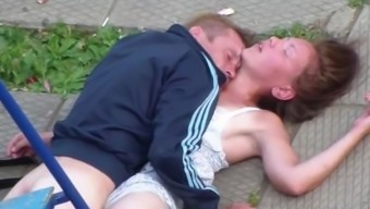 Drunk Partners Making out in the community Square