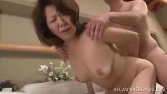 Hard love-making by using a naughty senior Oriental
