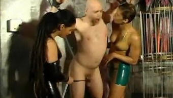 Two Dominatrix Punishes A Person who serves