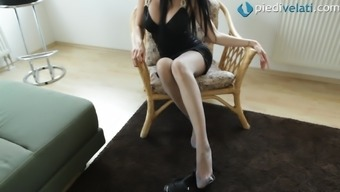 In her pantyhose the woman strips off her outfit to show her legs simultaneously and human body