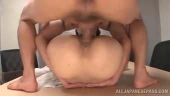 Splendid Japanese cowgirl moaning as this lady gets screwed in the office
