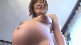 Asian preggo acts with the tits