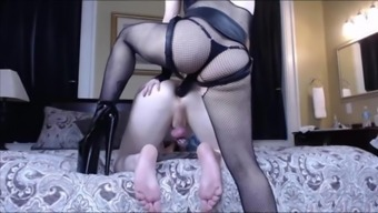 Domme pegging stud in chastity