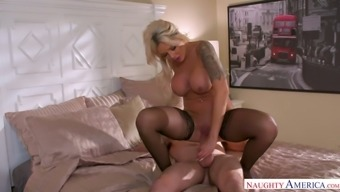 Stunning bosomy blonde MILF Nina Elle is hammered doggy style
