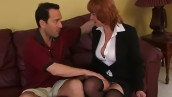 Mature redhead MILF gets her pussy pounded hard at the office