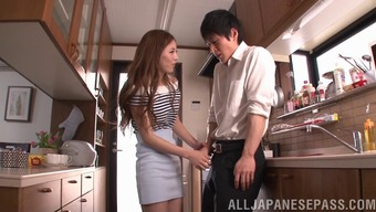 Japanese people seductress makes certain he fucks her very difficult with the cooking