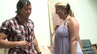 Plump MILF gets fucked by some people Asian stud within the value space