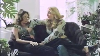 A couple of warm lesbian girls things their personal hairy twats by using a dildo