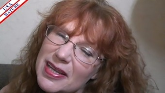 Nerdy housewife with eye-glasses easily places the shaft into her your mouth