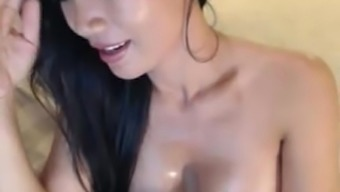 Horny brunette milf from asia petting on digicam