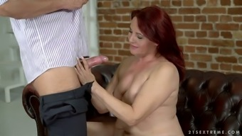 After blowing cock mature chubby redhead Red Mary is fucked doggy