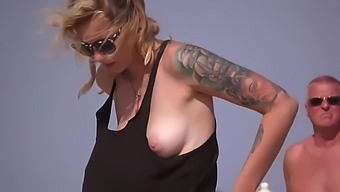 Fit topless blonde with hot natural tits on the beach !